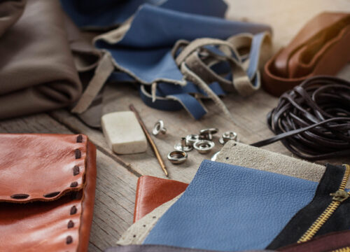 Tools and equipment for leather on wooden floors.